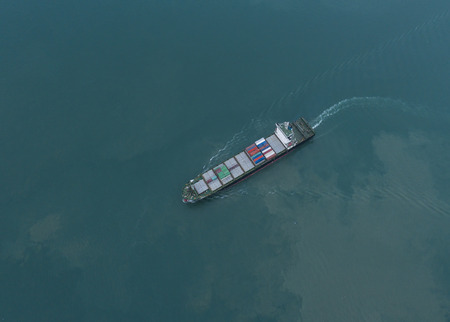 consignee: The commercial vessel carriage containers sailing in the Sea in arial view