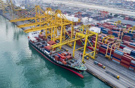 The busy of port congestion loading and discharging  containers services in maritime transports in World wide logistics Stock Photo