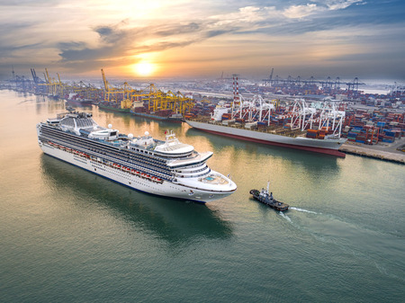 Luxury cruise ship proceed on sailing from port channel due on sunrise
