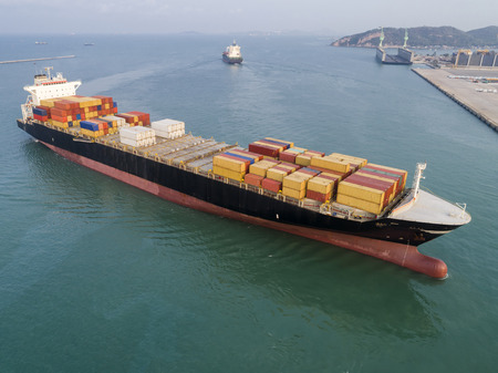 commercial ship of container vessel just arrival in approach to the channel due of the port Stock Photo