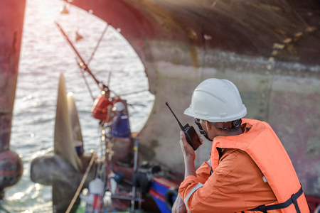 foreman in command repairing the ship in dock yard background Stockfoto