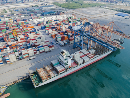 lading: container vessel ship loading and discharging operation in internationl port aerial view