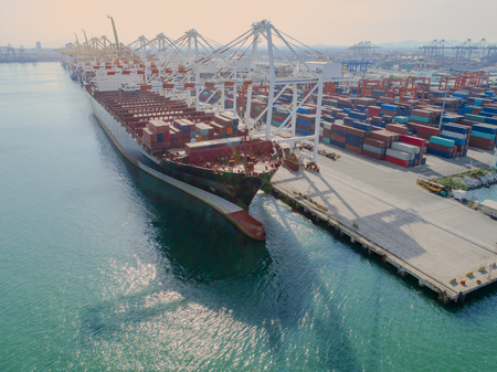 container vessel ship loading and discharging operation in internationl port, in aerial view Stock Photo