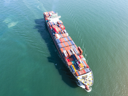 lading: container vessel ship sailing in the sea in aerial view