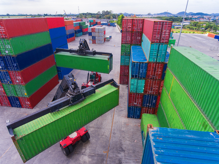 top view of container storage & works stacking tier to tier by the forklift, unit containers are standing by for transfer the cargo & shipment to the port upon the ship carrier arrive in terminal