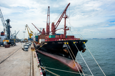 busy works in the port terminal by the vessel ship loaading and discharging operation to ensure the export and import economy are aim successfull in target of logistics transportation services