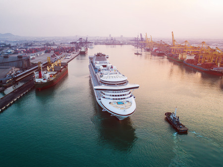 cruise luxury passenger ship under navigating to berth the terminal in an internaional port for transit the passenger tourist visit ashore city life