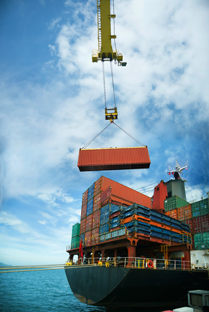 Unit of container being loading by the gantry crane of the port for transfering shipment from original port ot destination port by sera transportation carrier by the ocean vessel