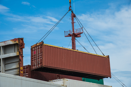 unit of container in loading by the ship's crane to storage on bay base on schedule for sequency in discharging port destination Stock Photo