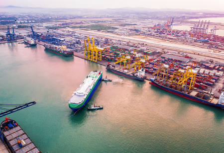 Congestion of international port services global worldwide to the various ships vessels in loading and discahring transferring the shipments of containers, RO RO services, gerneral cargo and contruction heavy lift including Stock Photo