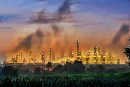 industrial Pollution, An industrial skyline at dusk, . Air pollution from smokestacks, ecology problems. Banco de Imagens
