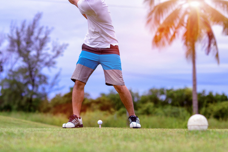 golf ball on the tee-off ready to impact by the hit of golfer after Addressing the ball in square and proper stance to the fairway forward Banque d'images