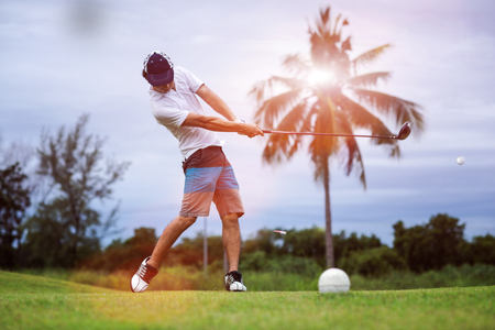 Fluffing of golf ball and tee flying away from the teeing ground impact by the golfer player after swing plane of proper stance addressing the ball