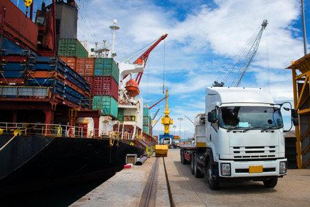 Delivery and transit cargo units of container from yard to the ship vessel loading in port terminal by trucking of lorry, the logistics system services to global worldwide transportation concept