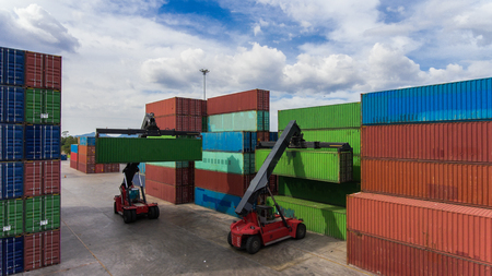 top view of container yard storage and stacking tier to tier by the forklift stacker, containers are standing by for transfer the cargo and shipment to the port upon the ship carrier arrive in terminal Stock Photo