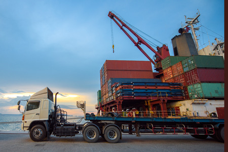 lorry trailer and truck delivery unit container to the ship in the port terminal, wharf where sea and land transport meet together being for transport and logistics services in global worldwide