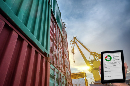containers unit are storage in port yard in status report for cargo delivery to the ship in port terminal by online mobile device to the office, clients and customers to ensure the loading status under control