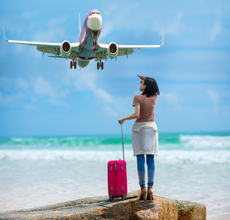 woman tourist imagine and planing to travel around the World on next vacation, CONCEPT looking forward to flying Stock Photo