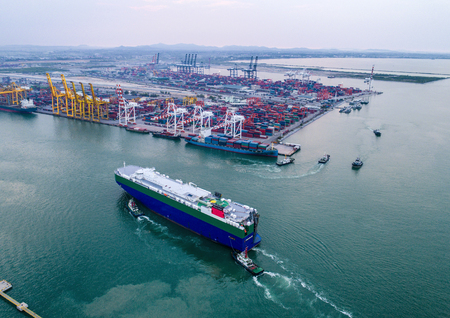 commercial ship arrive to the port under navigating by pilot to entrance chennel due, to along terminal for cargo transmission and transport to the worldwide