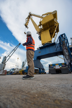 the operation control loading discharging carri on the cargo vessel in port terminal by stevedore gangs Stock Photo