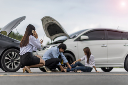 Woman calls for help and insurrant require after accident of car occurrence with injury people in soft focus background Stock Photo
