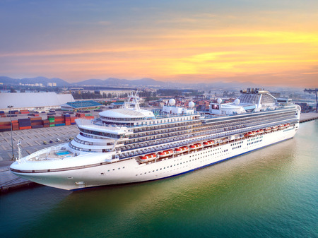 Passenger cruise ship stay in port terminal for transfer passenger on board traveling around the worldwide services