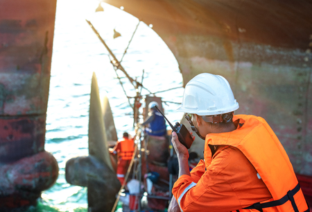 foreman in charge of command in repairing and replacement of shaft on propeller of the ship at medsea port by the workers and technician