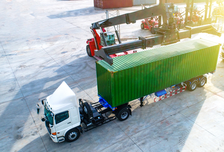 Aerial top view of unit of container loading onto the trailer by stacker, cargo ready to delivery to the destination by transportatio Stock fotó
