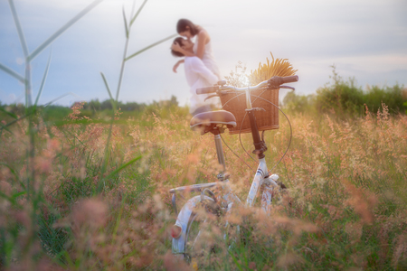 retro bycycle standing in the meadow flowers waiting couple lover, softening sweet and ramantic in valentine honeymoon occasion