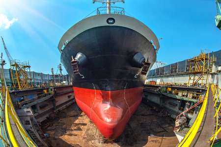 Top view of bulk head of the commercial bulk ship sitting on supporters of floating dry dock, after completed recondition of sand blasting and painting, ready to delivery to the sea services Фото со стока