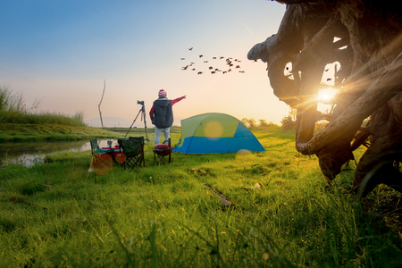 man photographer, traveller backpacker enjoy the nature of lake in the morning, traveling in vacation and long weekend in the countryside
