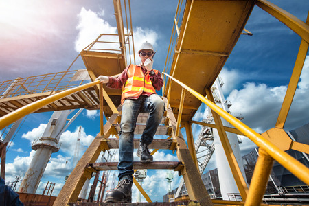 worker, engineering wearing safety shoe with set of safety and security regulation, walking in mind step on the steel gangway bridge at workplace, working in high stage & level of insurance 版權商用圖片