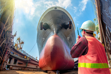 inspector, surveyor, port control or engineering and supervisor in review of the condition of the commercial ship bulk head after repainting recondition in dry dock yard, report, online