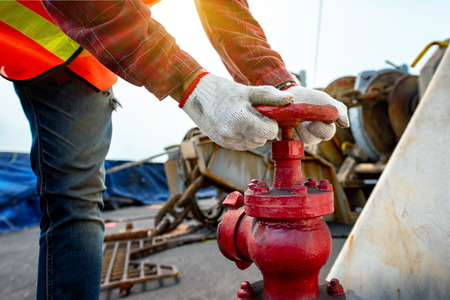 Close up hand opening or closing water valve in fire fighter in jobsite during training or inspecting, Fire fighting checking in safety priority