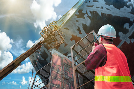foreman, supervisor, communination to worker or power man of painting gans or brush man in cherry picker crane, working in high position, working at risk in high level of insurance