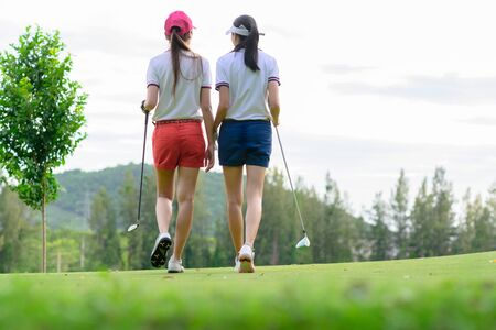 young golf players both walking to the fairway after hit the ball from T-OFF, next shot going takes on the fairway hit to thr gree Banco de Imagens