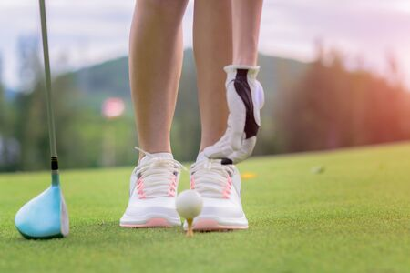 woman golf player prepare pin golf ball to the green, concentrate and ready to hit the ball away to the destination farway for winning in score rate