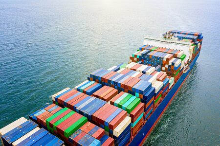 the large TEU container ship sailing in the sea carriage the shipment cargo from loading port to destination discharging port, transport and logistcs system services to worldwide Stock fotó