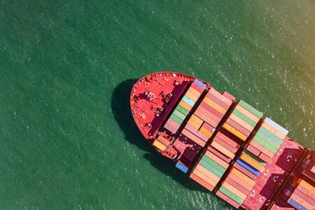 top aerial view of the bulk head of container ship sailing in the sea carriage the shipment from loading port to destination discharging port, transport and logistics services to worldwide Stock Photo