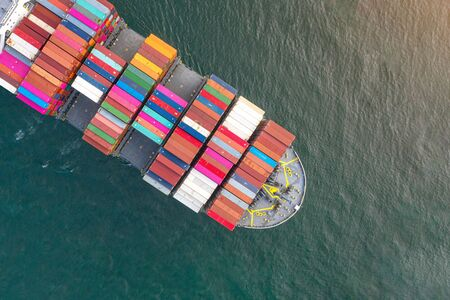 top aerial view of bulk head of containers ship sailing in the sea, carriage the shipment from loading port to destination discharging port, transport and logistics services to worldwide