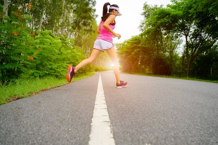 healthy woman jogging alone at daily morning in public park, daily exercise workout running of woman