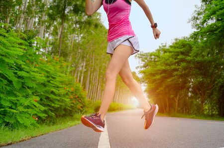 slim healthy woman being jogging trail running in the park, freshly exercise