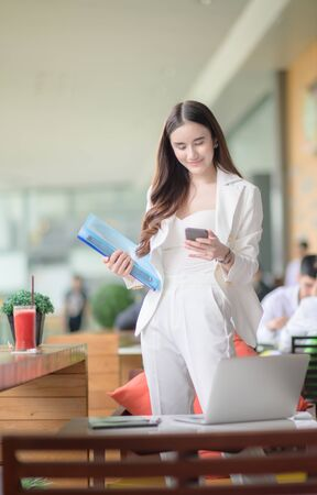 freelance working woman in busy of business, working outdoor online anytime and anywhere to reach customer satisfy