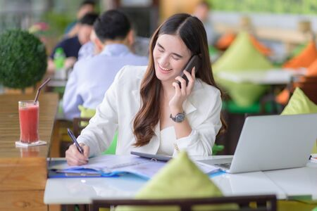 happy freelance working woman in busy of business, working outdoor online anytime and anywhere to reach customer satisfy Stock fotó