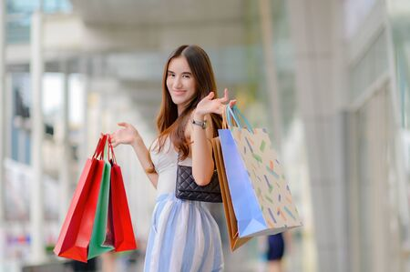 happy woman and joyful in shopping mall center, buying and shopping consumerism with many bags holding in both hands Stock Photo