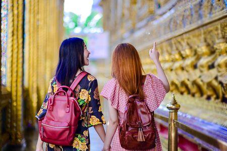young tourist women walking intothe palace temple in Bangkok of Thailand, Emerald Buddha Temple, Wat Phra Kaew, Bangkok Royal Palace popular tourist place Stock fotó