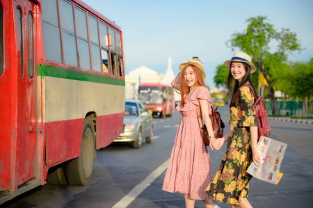 tourist women are going to get in Bus in Bangkok, traveling in urban bus city visit capital of Thailand Banco de Imagens