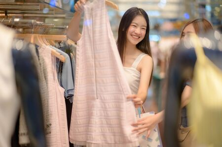 happy women and joyful and exciting in shopping mall center, buying and shopping consumerism, discount and sale period for customer shopping