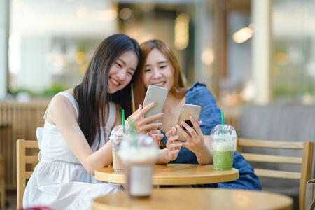 Device in both hands of young asian women online with social media in anywhere enjoying, life with live online connecting to the World update media Stock fotó