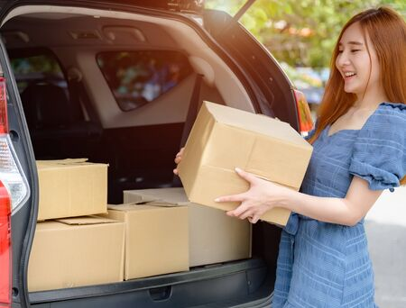 woman holding box packages delivery parcel to the customer, transport and quick delivery goods online by logistic services